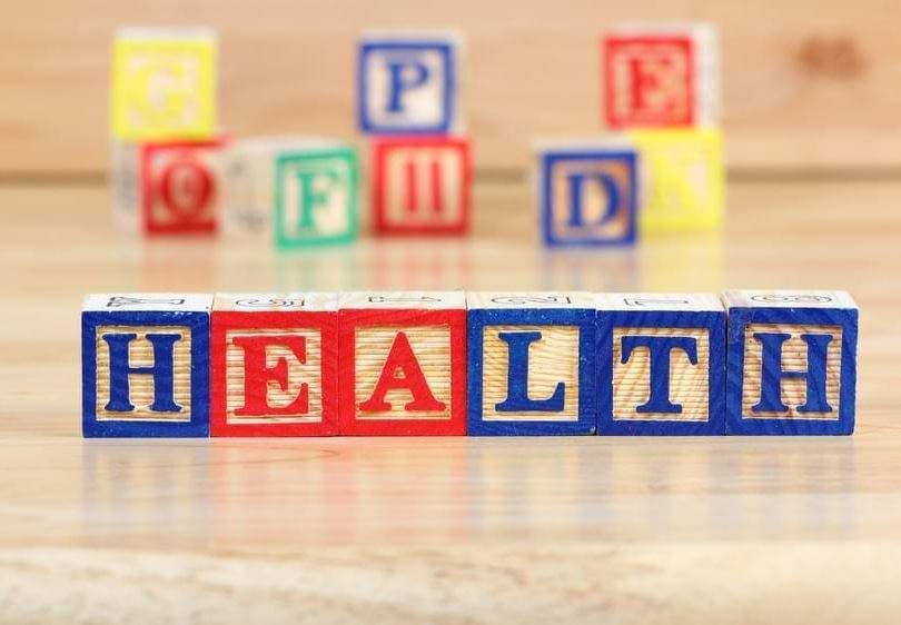 Letter block toys spell out the word 'Health'